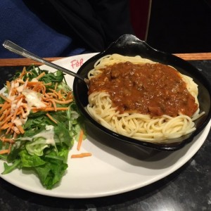Spaghetti Bolognese served with salad